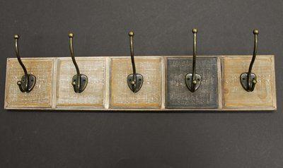Bronze Coloured Hooks on Wood