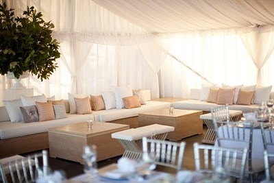 Soft seating is a nice addition to a wedding! Creating areas within your reception space where people can feel comfortable, socialize and still enjoy the music is going to impress your guests!
