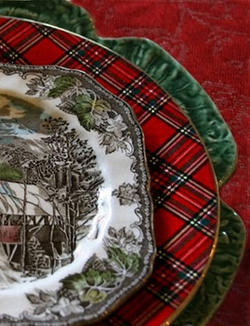 I love the layering of plates including the tartan, and toile.