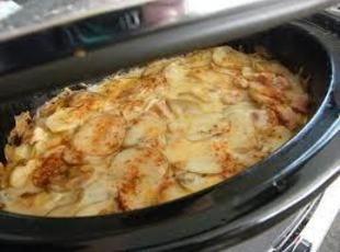 Crockpot Scalloped Potatoes & Ham Recipe. Making it as I type this...smells good!