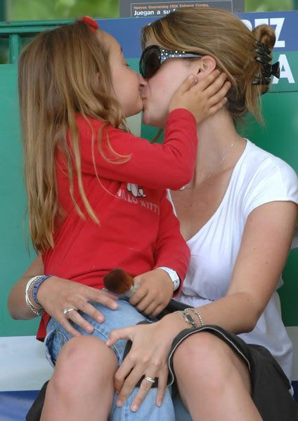 Athina Onassis Roussel de Miranda showing affection to her stepdaughter, Viviane.