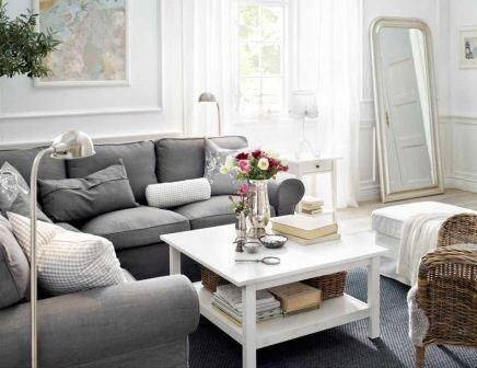 I like the gray, but we also have gray curtains. Maybe some bright throw pillows would be good here.