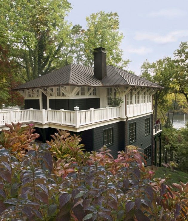 This cottage on the Severn River in the Maryland countryside is approached by a bridge leading to the main level. Donald Lococo Architects.
