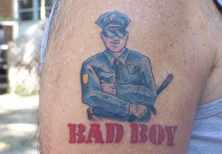 """This officer's """"Bad Boy"""" tattoo references Inner Circle's""""Cops""""theme song. - www.policemag.com - #police"""