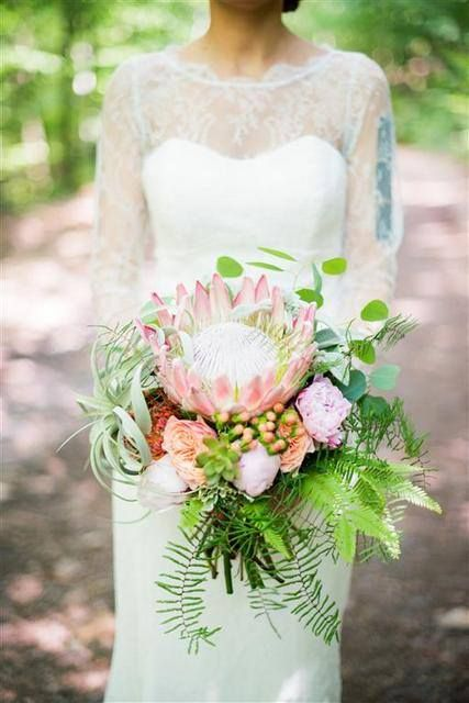 unique wedding bouquet of king protea, Australian greens and tillandsia.