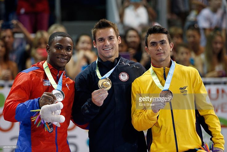 July 13 - Gymnastics Artistic - Men's All Around Final.  Silver medalist Manrique Larduet of Cuba, gold medalist Samuel Mikulak, and bronze medalist Jossimar Calvo Moreno of Columbia pose with their medals after the men's all around artistic gymnastics final on Day 3 of the Toronto 2015 Pan Am Games on July 13, 2015 in Toronto, Canada.