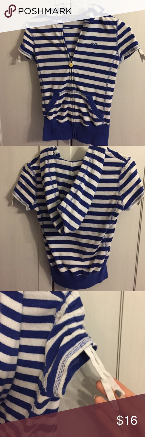 TNA (Aritzia) short sleeve zip up sweater This is a unique type of sportswear/swimwear cover up made of a cotton like material that mimics the feel of a towel. With a nautical theme of blue and white stripes. Aritzia Sweaters