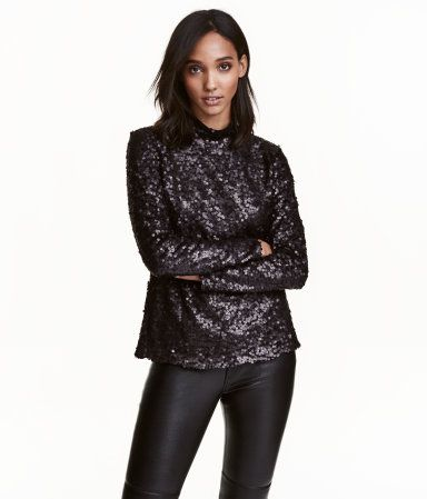 Black. Mock-turtleneck top in sequined mesh with long sleeves and concealed back zip. Lined.