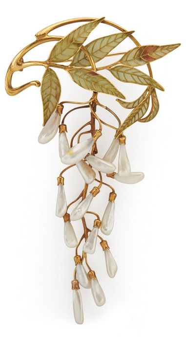 An Art Nouveau enamel, pearl and gold brooch, attributed to Henri Vever, circa 1900. Articulated brooch with plique-à-jour enamel foliage and dogtooth pearl wisteria blossoms, possibly after a design by René Lalique. French eagle mark for 18k, no maker mark evident. #HenriVever #ArtNouveau #brooch