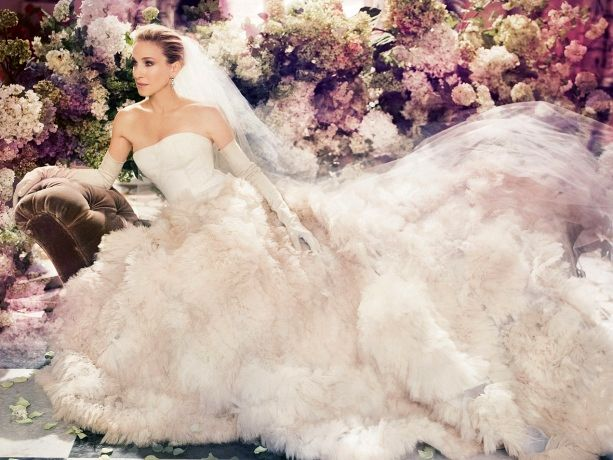 Elegant Sarah Jessica Parker wearing a gorgeous Vera Wang wedding gown during the Vogue photo shoot in