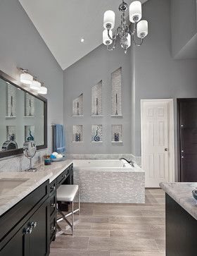 Transitional bathroom.  Create an oasis with dark cabinetry with simple lines and marble surfaces combined with tile.