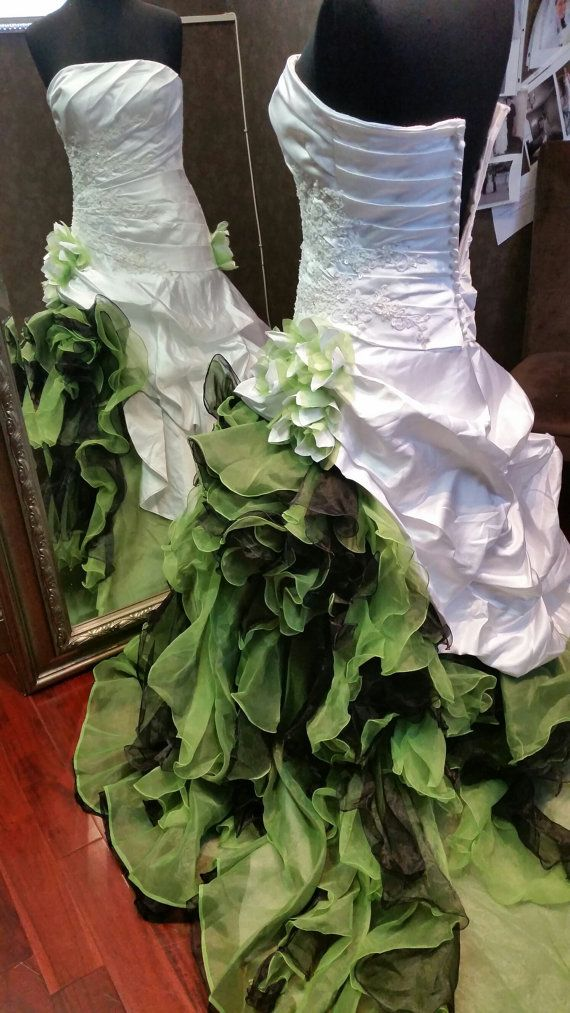 This showstopping White and Green Wedding Dress from www.WeddingDressFantasy is created with a Couture construction and is available in many