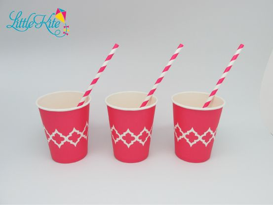 Moroccan tile paper party drinking cups and matching paper straws in Fuschia hot pink.