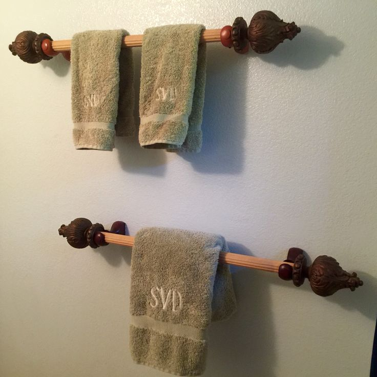 Drapery rods with fancy ends cut into towel bars/rods for the bathroom.