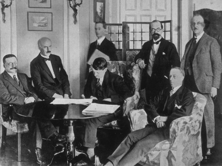 "Members of the Irish delegation at the signing of the Irish Free State Treaty on December 6, 1921. ""Today I sign my deth warrant"""