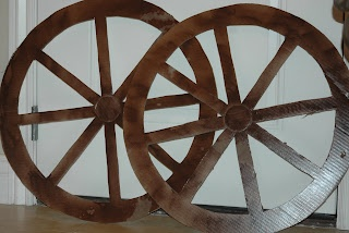 Western party (homemade) decorations  Chuck wagon wheels for drink table