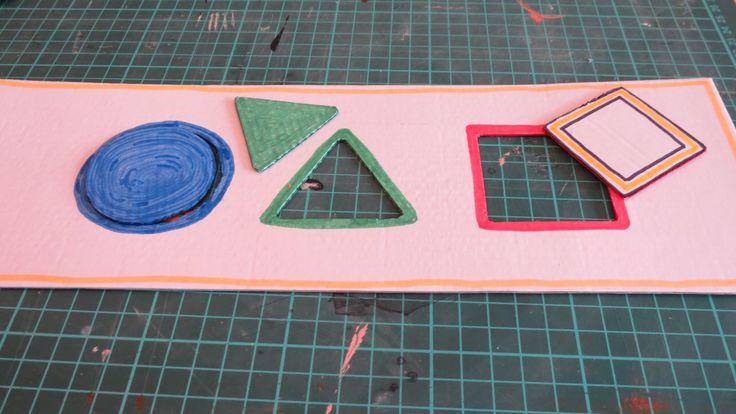 puzzle con forme e colori dal riciclo di una scatola per alimenti