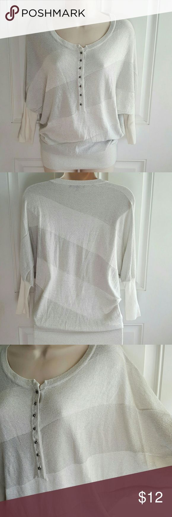 "MATTY M Silver Sparkle Ivory Blouson Top Lightweight. Elbow length batwing sleeve.  Half button. Blouson style elastic ribbed hem.  87% rayon 13% lurex.  Bust 23"" Length 29"" Matty M Tops"