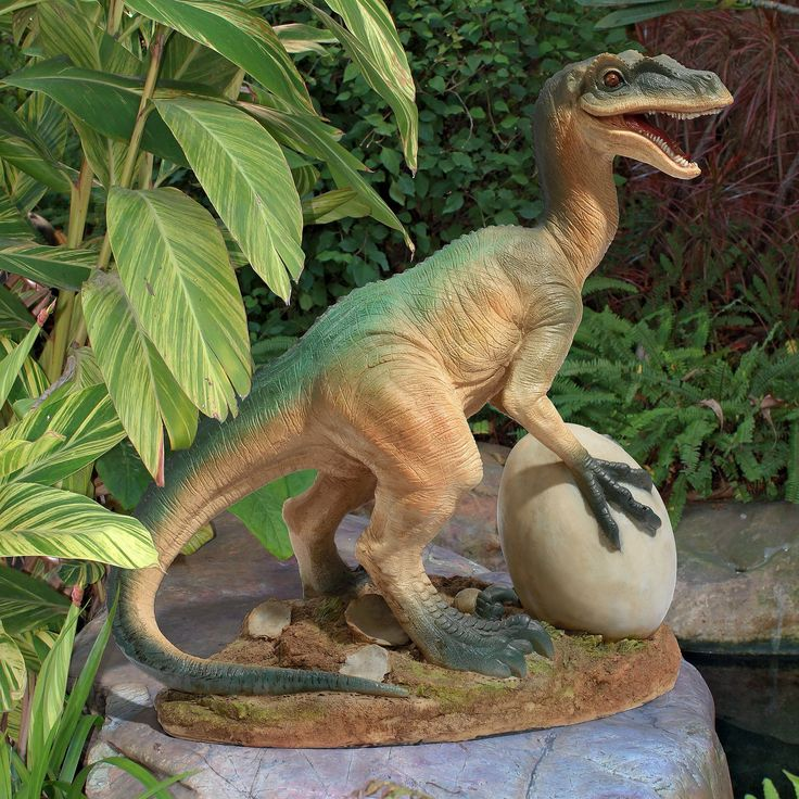 The Egg Beater Raptor Dinosaur Statue