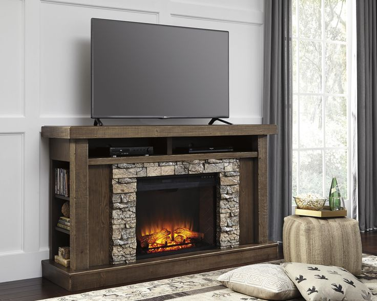 Featuring a built-in electric fireplace that can be controlled with the touch of a button, this console provides a safer alternative to a traditional wood-burning fireplace. Designed to be the best of both worlds, the console ensures space for your media devices and accessories, and allows you to have the benefit of a fireplace without needing to mount your television on the wall above.