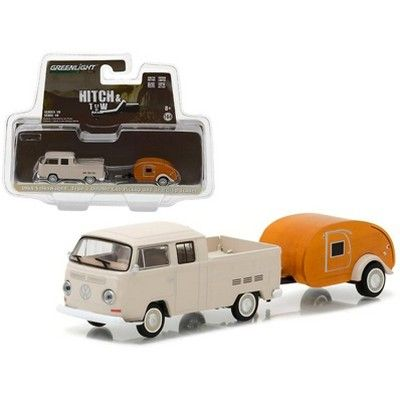 Brand new 1:64 scale car model of 1968 Volkswagen Type 2 Double Cab Pickup and Teardrop Trailer Hitch & Tow Series 10 die cast car model by Greenlight. Limited Edition. Detailed Interior, Exterior. Metal Body. Comes in a blister pack. Officially Licensed Product. Dimensions Approximately L-7 Inches Long. All trailers come with corkscrew jacks for stand-alone display.TONY Cin