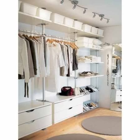 See those low cupboards? Never use that space except for piles // Round Rug IKEA Closet Organizers