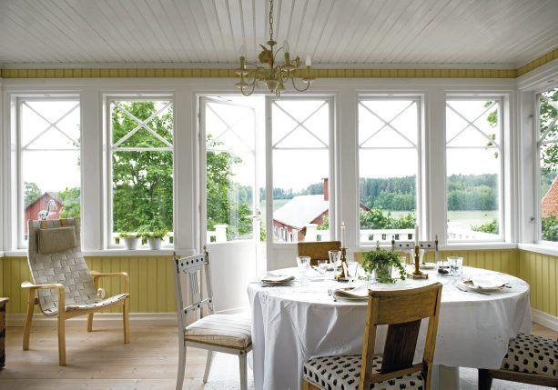 swedish yellow paneled sunrooms & water views
