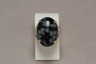 Sterling Silver and Snowflake Obsidian ring by Iridonousa on Etsy, $110.00...yeah a little expensive and big but I'd wear it...somehow :P