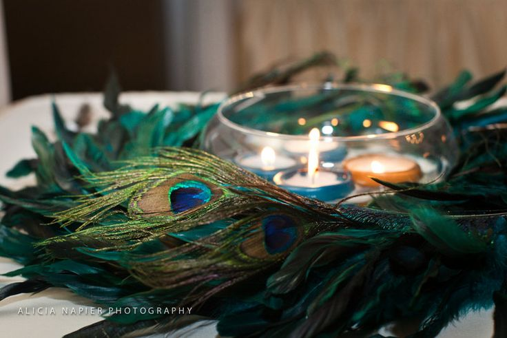 Peacock themed wedding floating candle centerpieces