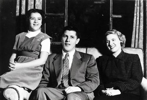 1,956: Ann appears to be around 14 years old, so this is maybe 1956. Left to right: Ann Dunham (1942-1995), Stanley Armour Dunham (1918-1992...