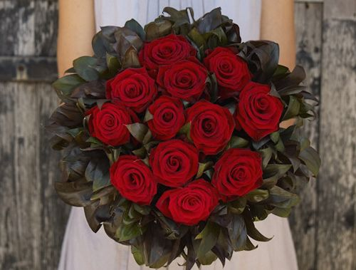 True Romance Bouquet Of A Dozen Red Roses Surrounded By Collar Black Cordeline Foliage