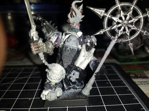 Chaos Sorcerer Lord. In progress . .Built up from a badly converted and more or less destroyed Space Marine terminator. Tzeentch banner in progress. Further photos to come.