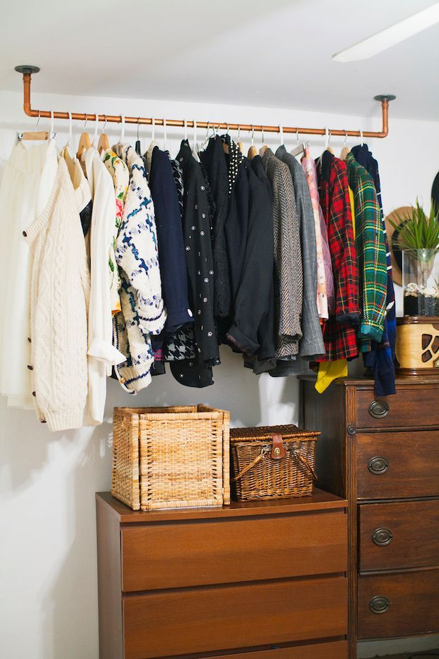 How To: Hanging Copper Pipe Clothes Rack - Maybe for curtains in the steampunk bedroom, with the curtain on rings. It'd make the window look taller if the curtains started up by the ceiling.  (Under the stairs in the mudroom)