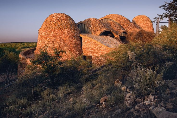 Mapungubwe Interpretation Centre at Mapungubwe National Park in Limpopo, South Africa. The plan for this visitor center, designed by Peter Rich Architects, began with a motif etched on stones uncovered at the former location of a South African trading civilization. Its free-form vaults were built with a 600-year-old construction technique that is both economically and environmentally responsible: Local laborers made the 200,000 pressed soil tiles as part of a poverty relief program. Though…