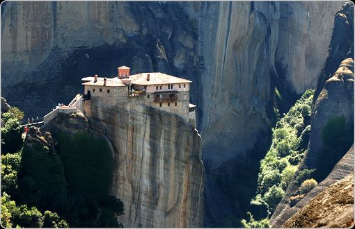 "The Metéora, which means ""rocks suspended in the air"" are  sandstone pillars that have survived erosion. They may be found in Greece, and it is on these Metéora that Roussanou Monastery was built"