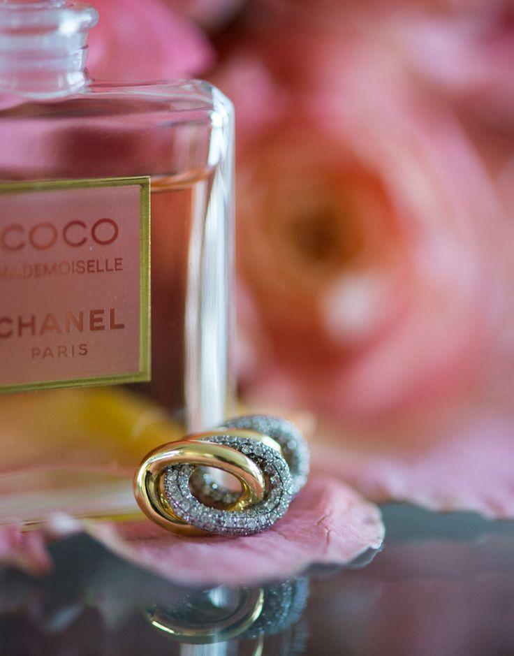 Perfume, earrings and roses.