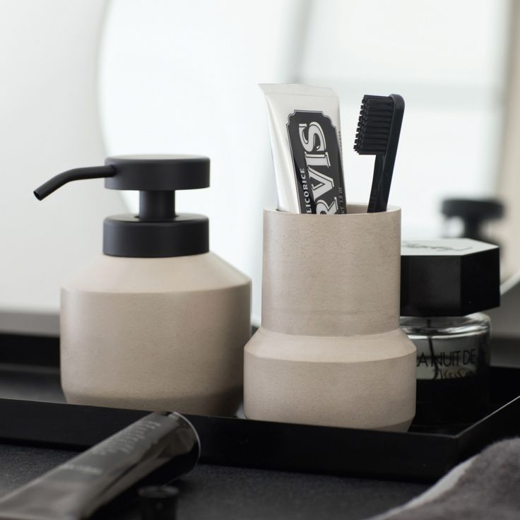 Designstuff offers a range of Scandinavian bathroom accessories including this stylish concrete toothbrush holder/tumbler by Mette Ditmer.