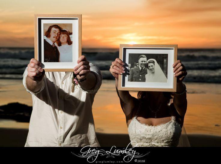 Bride and Groom with photos of their parents wedding days.  Great wedding idea.  Beach wedding.