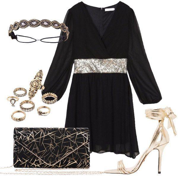 Il vestito nero ha un modello ampio che stringe in vita con una cintura di paillettes oro, lo scollo incrociato a V, l'orlo al ginocchio e la manica lunga trasparente. Ai piedi sandali con tacco a spillo alto e lacci dorati che si allacciano alla caviglia. Come borsa una pochette rigida nera con fantasia di foglie oro e tracolla a catena dorata. Per finire fascia per capelli composto di strass oro ed argento, come gioielli ho scelto un set di ane...