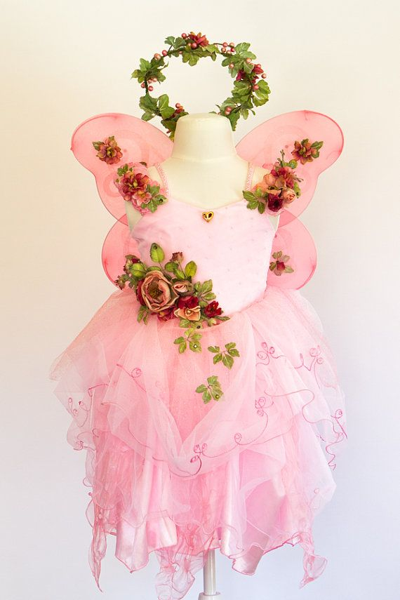 This sweet and magical fairy costume in rose with adorable dark pink accents is certain to charm! Perfect for parties or playtime, this