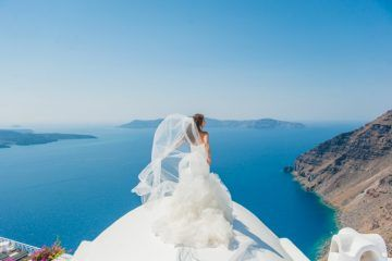 Intimate Wedding Abroad in Santorini by Phosart Photography & Cinematography
