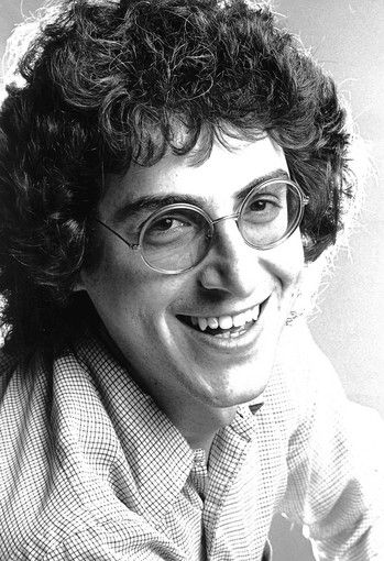Harold Ramis began performing with Second City in 1969. After leaving Second City for a time and returning in 1972, having been replaced in the main cast by John Belushi, Ramis worked his way back as Belushi's deadpan foil. In 1974, Belushi brought Ramis and other Second City performers, including Ramis's frequent future collaborator, Bill Murray, to New York City to work together on the radio program The National Lampoon Radio Hour (which ran November 1973 to December 1974)