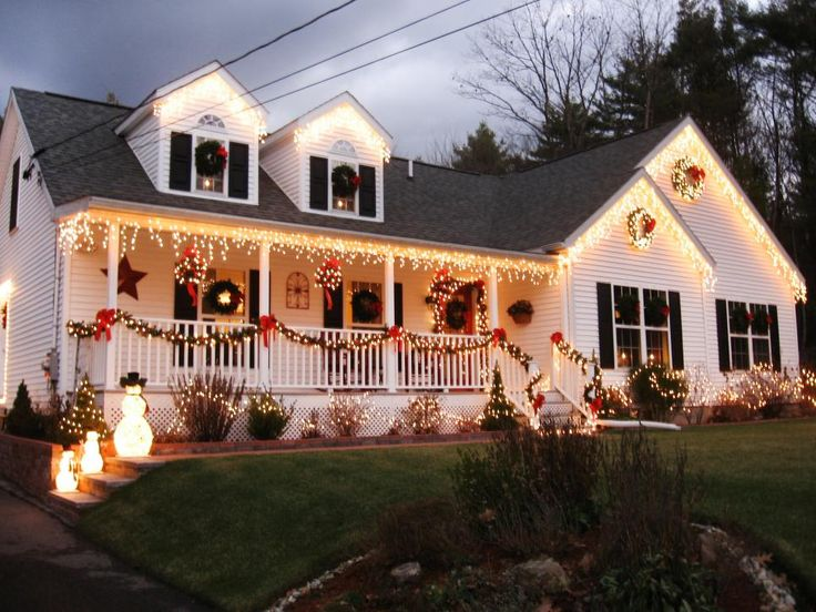 Each window on this Massachusetts home is covered by simple green wreaths for a classic Christmas look. HGTV fan MIA123 embellished the simple look with bright icicle lights on the porch and lights around the shrubbery.
