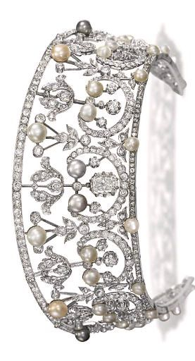 A BELLE EPOQUE TIARA  Of kokoshnik design, the old-cut diamond foliate openwork band interspersed with button-shaped cultured pearls and (untested) pearls of varying hues, the centre set with a cushion-shaped diamond, adapted, circa 1905, 33.0 cm inner circumference