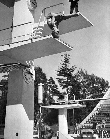 1952. Pat McCormick competing in the Olympic Diving Competition