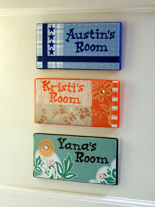 use subway tiles and create name plates. Use scrapbook paper, paint, stickers, gems, stencils and/or sticker alphabet, etc. Stick double sided mounting pads to back and stick to bedroom door (or use a hook of you don't want to stick to the door).