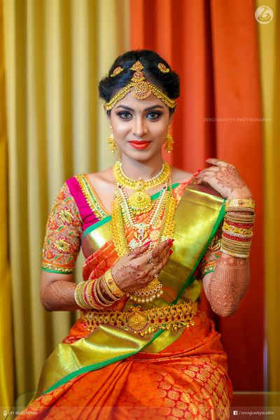 South Indian bride. Gold Indian bridal jewelry.Temple jewelry. Jhumkis.Red silk kanchipuram sari.Braid with fresh jasmine flowers. Tamil bride. Telugu bride. Kannada bride. Hindu bride. Malayalee bride.Kerala bride.South Indian wedding. Pinterest: @deepa8