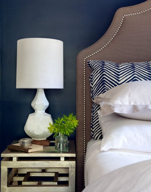 Love the dark blue walls and pillow but this really makes me want a DIY headboard!