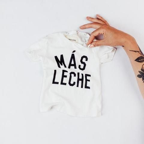 Super cute tee shirt that says more milk in Spanish! True to Size. Organic cotton, LA made, enzyme washed & hand printed.