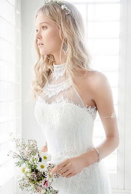Brides: Ti Adora by Alvina Valenta. Ivory English net and lace bridal gown with a high necked sheer illusion and lace halter.